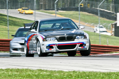 Paul Davison and his immaculate and newly wrapped BMW M3 attacking the historic and challenging Mid-Ohio Sports Car Course during NASA Great Lakes Region German Touring Series, August 2010